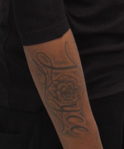 Yasir Pressley - arm tatoo